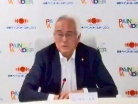 記者発表する田中社長